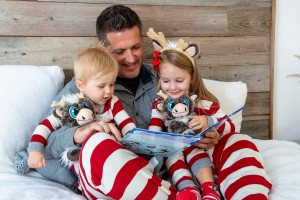 Dadpreneur Adam Reed with his kids and creation