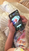 A young fan plays with her favorite Fungisaur on the Fungisaurs AR app.